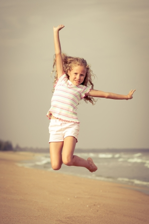 air jump: flying jump beach girl on blue sea shore in summer vacation