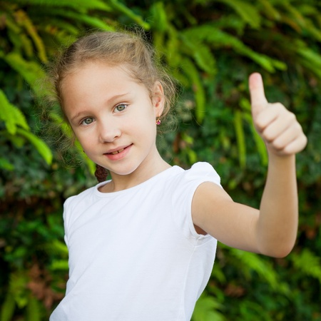 happy girl shows gesture cool photo