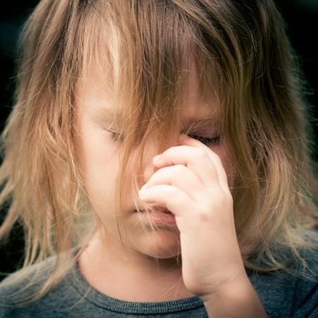 portrait of sad shaggy little girl photo