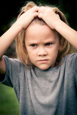 misery: portrait of sad shaggy little girl Stock Photo