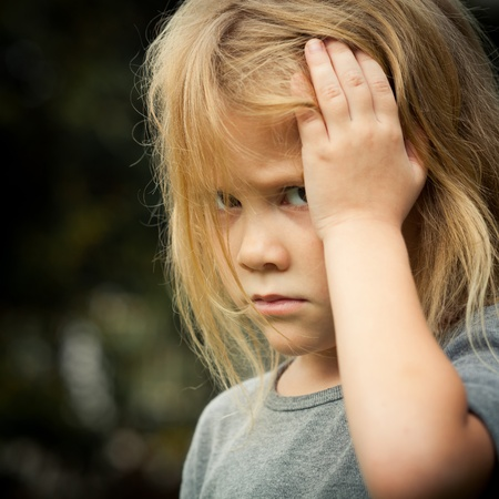 scared child: portrait of sad shaggy little girl Stock Photo