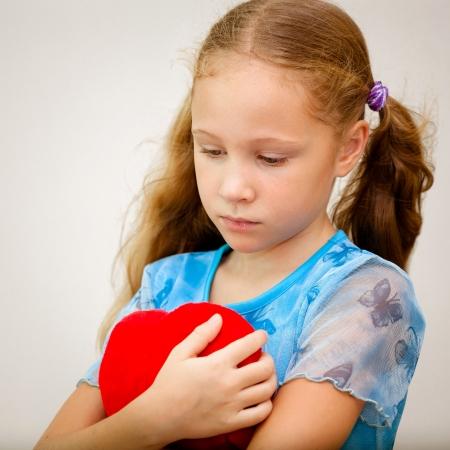 heart pain: Portrait of sad child
