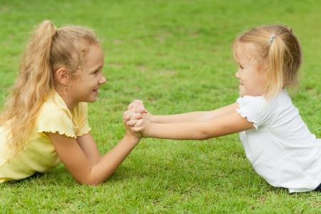 friendship day: two happy little girls