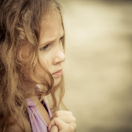 resentment: Portrait of sad child
