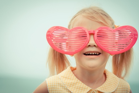 kids having fun: Adorable happy smiling girl on beach vacation
