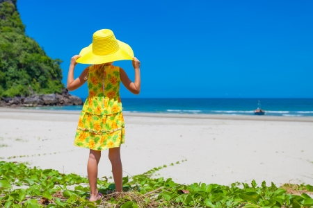 kids dress: Adorable happy smiling girl on beach vacation