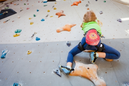 Little Girl Climbing Rock Wall photo