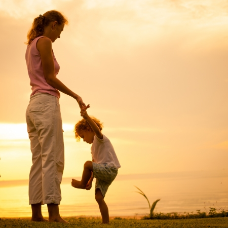 mother and  son playing on the beach photo