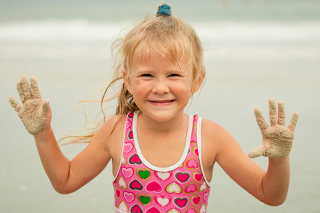 Little girl playing on the beach  photo