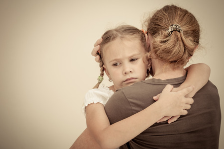 forgiveness: sad daughter hugging his mother