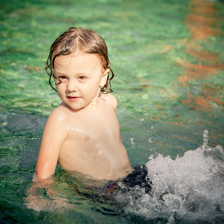 little boy in the swimming pool photo