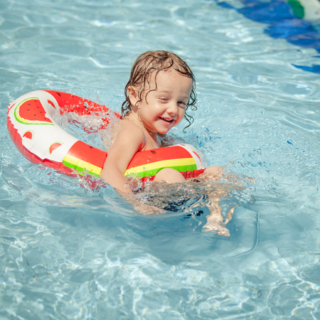 little boy in the swimming pool  with rubber ring photo