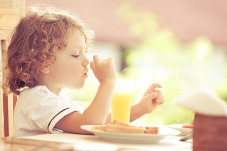 little boy at breakfast photo