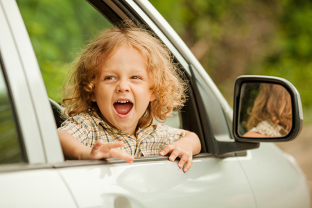 Portrait of a screaming little boy who sitting in the car Stock fotó