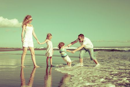 family beach: Happy family playing at the beach in the day time