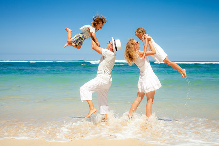 Happy family playing on the beach at the day time Banque d'images