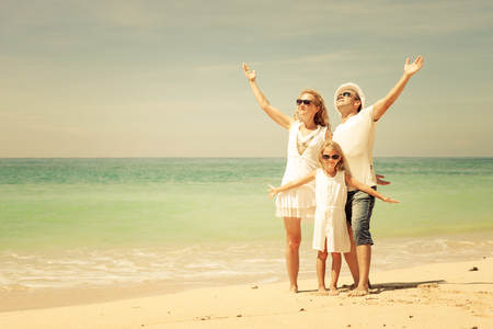 Happy family walking at the beach at the day time  Concept of friendly family  photo