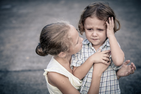 lost child: Portrait of sad teen girl and little boy at the day time Stock Photo