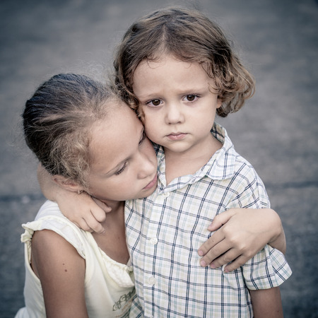 brothers and sisters: Portrait of sad teen girl and little boy at the day time Stock Photo