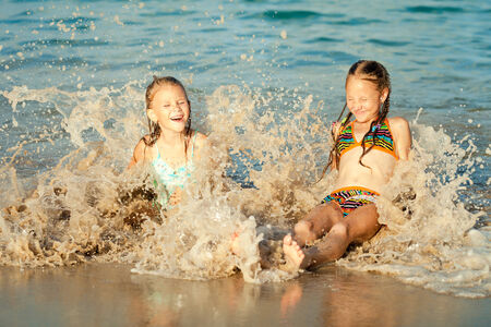 happy kids playing on beach at the day time photo