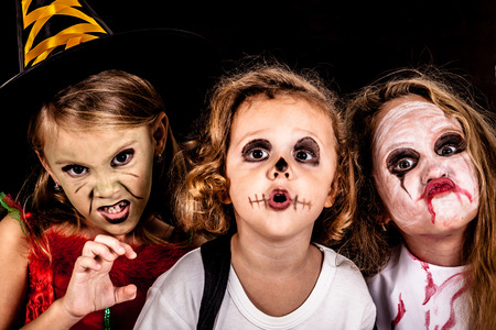 Happy brother and two sisters on  Halloween party Stock Photo