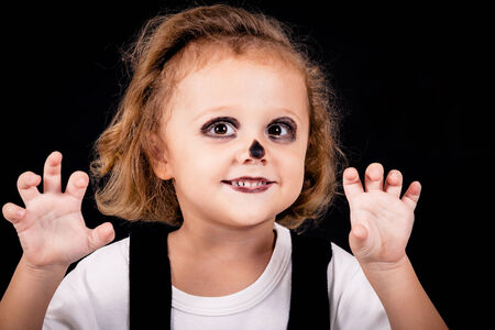 Cute little boy on Halloween party photo