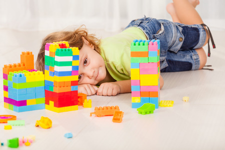 one room school house: Little boy playing blocks on the floor at home