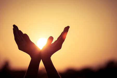 sun: silhouette of female hands during sunset