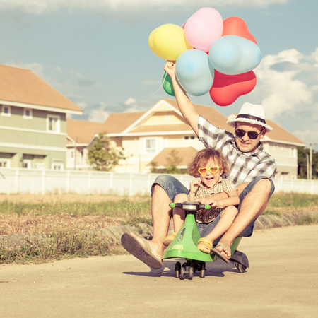 father and son playing near a house at the day time Stock Photo - 33591784