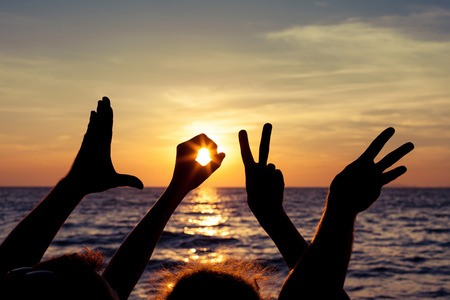 human relationships: Love  sign language at the sunset time