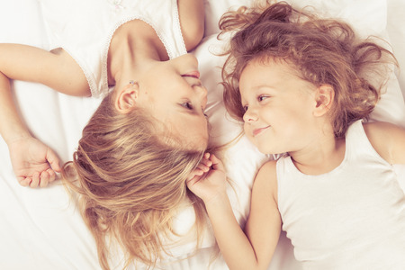 brothers and sisters: Lovely brother and sister lying in bed at home. Concept of Brother And Sister Together Forever