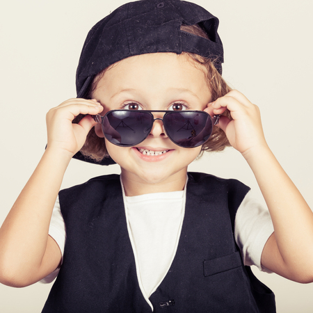cool kids: portrait of a little boy in studio