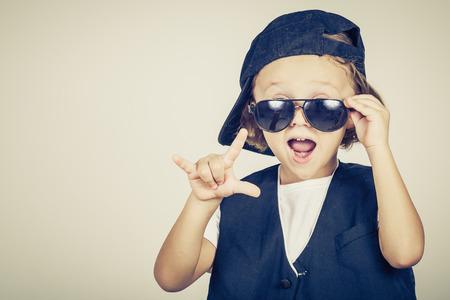 cool guy: portrait of a little boy in studio