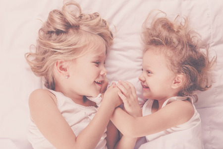brother sister: Lovely brother and sister lying in bed at home. Concept of Brother And Sister Together Forever