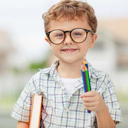 boy beautiful: Portrait of Beautiful school boy looking very happy outdoors at the day time. Concept school theme.