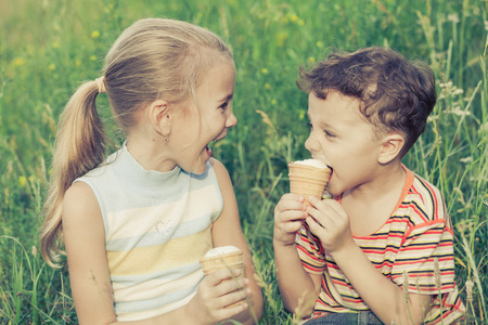 brother: Two happy children  playing in the park at the day time. Concept Brother And Sister Together Forever