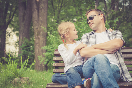 father daughter: Father and daughter playing at the park at the day time. Concept of friendly family. Stock Photo