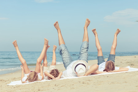 women having fun: Happy family playing  on the beach at the day time. Concept of friendly family.