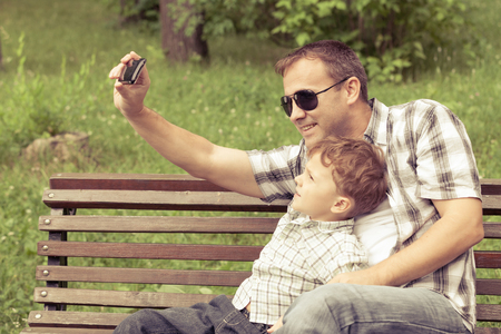 father and son: Father and son playing at the park at the day time. Concept of friendly family. Stock Photo