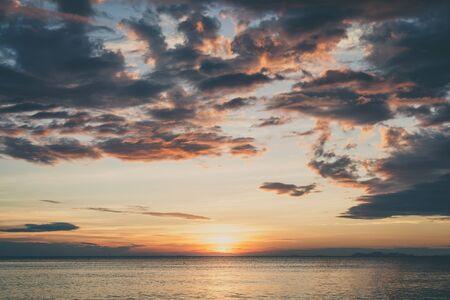 sunset sky: Sunset on the beach with cloudyl sky Stock Photo