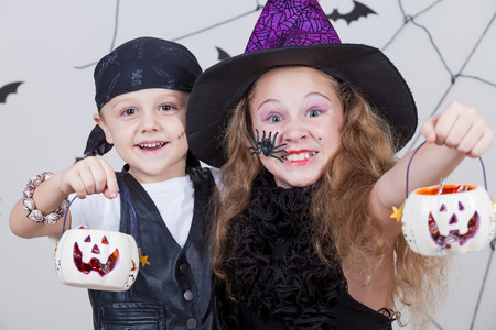 Happy brother and sister on Halloween party Imagens