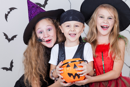 witch spider: Happy brother and two sisters on Halloween party