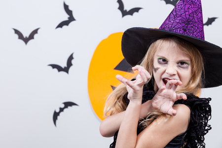 scary girl: Happy little girl on Halloween party