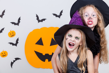 scary girl: Two happy sisters on Halloween party