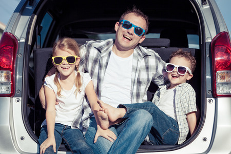 Happy family getting ready for road trip on a sunny day.  Concept of friendly family. Zdjęcie Seryjne