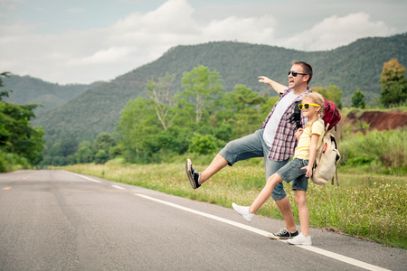 couple nature: Father and daughter walking on the road at the day time.  Concept of friendly family. Stock Photo