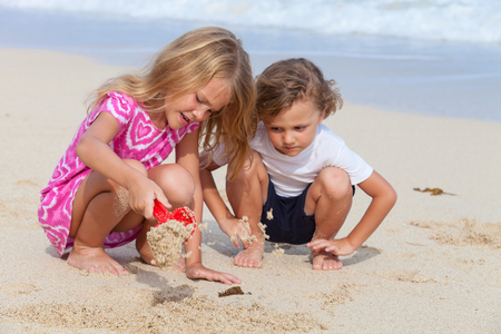 two children: Two happy children  playing on the beach at the day time.