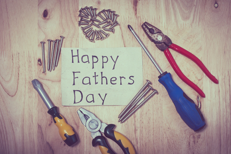 father: Set of different tools on wooden background. Concept of happy fathers day.