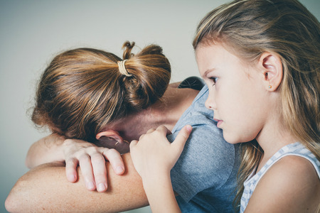 depression: sad daughter hugging his mother at home. Concept of couple family is in sorrow.
