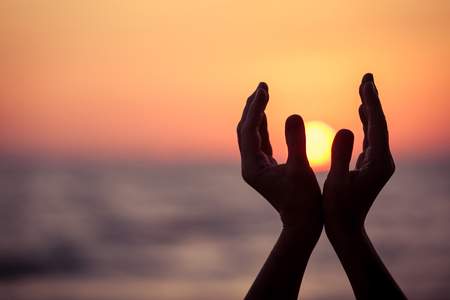 silhouette of female hands during sunset. Concept of life. Banco de Imagens